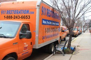 Water Damage Restoration Truck At Curb Location