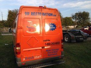Water Damage Restoration Rear Of Van At Dusk