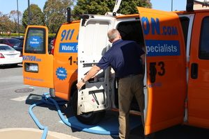 Water Damage Restoration Van And After Job Cleaning