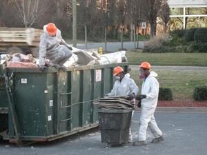 Restoration Technicians Doing Debris Removal