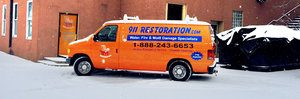 Water Damage and Mold Removal Van At Civic Job Site