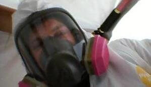 Water Damage Lowell Technician With Gas Mask