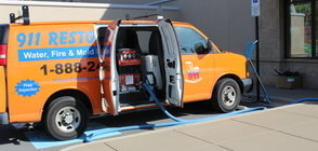 Mold Damage Restoration Van At Exterior Of Job Location